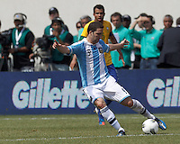 Argentina forward  Gonzalo Higuain (9) passes the ball. In an international friendly (Clash of Titans), Argentina defeated Brazil, 4-3, at MetLife Stadium on June 9, 2012.