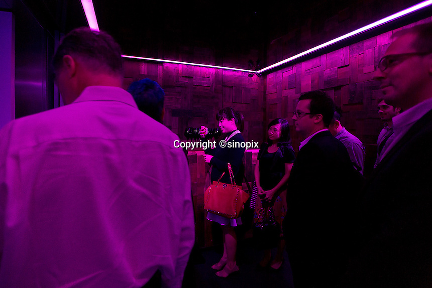 Diners gather at the entrance and waits for the dinning room doors to be opened at the Ultraviolet restaurant in Shanghai, China on 27th Sept 2013.  The restaurant in run by Chef Paul Pairet. <br /> <br /> Photo by Qilai Shen / Sinopix