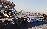 Oct. 14, 2011; Chandler, AZ, USA; NHRA top fuel dragster driver Cory McClenathan blows a fuel line causing fuel to spill during qualifying at the Arizona Nationals at Firebird International Raceway. Mandatory Credit: Mark J. Rebilas-
