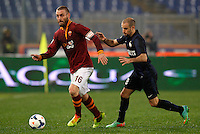 Calcio, Serie A: Roma vs Inter. Roma, stadio Olimpico, 1 marzo 2014.<br /> AS Roma midfielder Daniele De Rossi, left, is chased by FC Inter forward Rodrigo Palacio, of Argentina, during the Italian Serie A football match between AS Roma and FC Inter at Rome's Olympic stadium, 1 March 2014.<br /> UPDATE IMAGES PRESS/Riccardo De Luca
