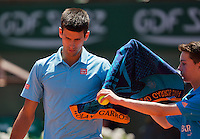 France, Paris, 04.06.2014. Tennis, French Open, Roland Garros, Novak Djokovic (SRB) receives a towel from a ballboy<br /> Photo:Tennisimages/Henk Koster