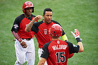 Team USA JP Crawford (3) high fives Kyle Waldrop (15), as Tony Kemp looks on, after scoring a run during the MLB All-Star Futures Game on July 12, 2015 at Great American Ball Park in Cincinnati, Ohio.  (Mike Janes/Four Seam Images)