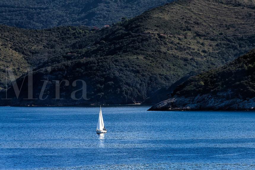 Sailboat on the waters surrounding the iland of Elba, Tuscony, Italy.