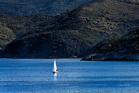 Sailboat on the waters surrounding the iland of Elba, Tuscony, Italy.