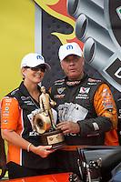 May 11, 2013; Commerce, GA, USA: NHRA funny car driver Johnny Gray celebrates with his wife after winning the Southern Nationals at Atlanta Dragway. Mandatory Credit: Mark J. Rebilas-