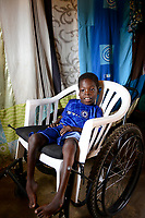 TOGO, Tohoun, village ADJIKAME, young handicapped boy in wheelchair