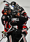 28 January 2012: Northeastern University Huskies' defenseman Dan Cornell, a Freshman from Abington, MA, celebrates a goal with teammates during play against the University of Vermont Catamounts at Gutterson Fieldhouse in Burlington, Vermont. The Huskies defeated the Catamounts 4-2 in the second game of their 2-game Hockey East weekend series. Mandatory Credit: Ed Wolfstein Photo