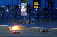 Feb 21, 2009; Fontana, CA, USA; NASCAR Nationwide Series driver Michael McDowell drives in flames after blowing an engine during the Stater Bros 300 at Auto Club Speedway. Mandatory Credit: Mark J. Rebilas-