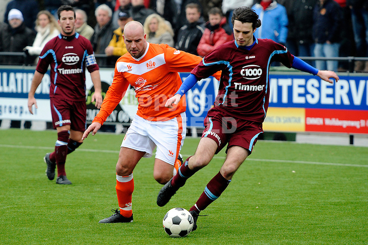 EMMEN - Voetbal, WKE - FC Lienden, Sportpark Grote Geert,  seizoen 2011-2012, 29-01-2012,  FC Lienden speler Julien van Diest (r) is WKE speler Andy van der meyde de baas.