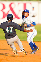 Bluefield Blue Jays second baseman Christian Lopes #1 turns a double play as Jabari Henry #47 of the Pulaski Mariners begins his slide at Bowen Field on July 1, 2012 in Bluefield, West Virginia.  The Mariners defeated the Blue Jays 4-3.  (Brian Westerholt/Four Seam Images)