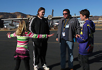 Cerified Flight Instructor Joshua Hochberg disusses flying with young people about to go on a flight at a Young Eagles Rally at Lampson Field (102), Lakeport, California