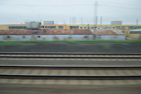 AVAILABLE FROM JEFF FOR COMMERCIAL AND EDITORIAL LICENSING.<br /> <br /> Industrial Scene with Warehouse Buildings seen from Window of Moving Commuter Train, Central New Jersey, USA