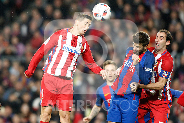 FC Barcelona's Gerard Pique (c) and Atletico de Madrid's Fernando Torres (l) and Diego Godin during Spanish Kings Cup semifinal 2nd leg match. February 07,2017. (ALTERPHOTOS/Acero)