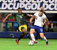 DALLAS, TX - JULY 25: Cory Burke #9 of Jamaica attempts to strip the ball from James Sands #16 of the United States during a game between Jamaica and USMNT at AT&T Stadium on July 25, 2021 in Dallas, Texas.