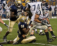 Pitt Panthers linebacker Jemeel Brady tries to hang on to Connecticut Huskies running back Donald Brown during the Huskies 34-14 victory on September 22, 2007 at Heinz Field, Pittsburgh, Pennsylvania.
