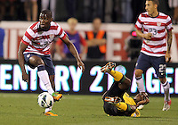 COLUMBUS, OHIO - SEPTEMBER 11, 2012:  Maurice Edu (7) of the USA MNT knocks over Omar Cummongs (10) of  Jamaica during a CONCACAF 2014 World Cup qualifying  match at Crew Stadium, in Columbus, Ohio on September 11. USA won 1-0.