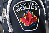 Hamilton Police badge is seen during a police memorial parade in Ottawa Sunday September 26, 2010.