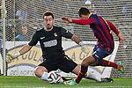 Real Sociedad's Enaut Zubikarai (l) and FC Barcelona's Alexis Sanchez during La Copa match.February 12,2014. (ALTERPHOTOS/Mikel)