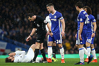 Fernando Llorente of Swansea City lies on the ground after after a collision with David Luiz of Chelsea during the Premier League match between Chelsea and Swansea City at Stamford Bridge, London, UK. Saturday 25 February 2017
