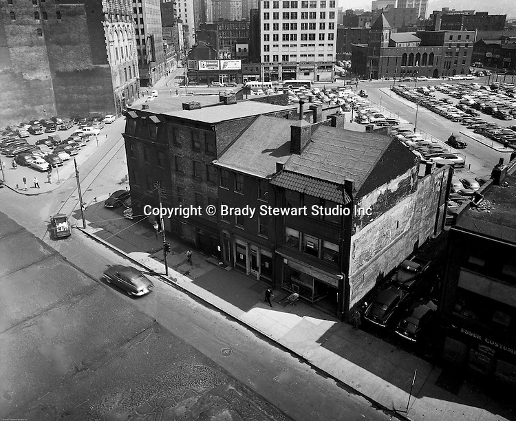 Pittsburgh PA:  View of the city of Pittsburgh before Gateway Center.  The corner of Liberty Avenue and 4th Avenue.  Company signs on the city buildings include: Salvation Army billboard, 1940s Texaco Gas billboard, 1940s billboards, 1940s parking lots in Pittsburgh, 3rd Avenue, 3rd Avenue in Pittsburgh, Esser Costume, Fourth Avenue in Pittsburgh, G&W Leach Company, Kelly Tires on Boulevard of the Allies, Knapp Brothers Company on Boulevard of the Allies, Lord Electric Company, Minsky Brothers & Company on Stanwix Street, St Mary of Mercy Church, The Pittsburg News Company on Stanwix Street