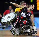 Patrice Simard (15) of Quebec City takes a tumble and loses the ball in front of Ryley Batt of Australia in Canada's 41 - 40 loss to Australia in wheelchair rugby semi-final action in Beijing during the Paralympic Games, Monday, Sept., 15, 2008.   Photo by Mike Ridewood/CPC