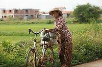 Battambang - Cambodia - June 2020<br /> Old woman on bicycle