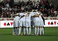 Pictured: Swansea players huddle before kick off. Tuesday 28 August 2012<br /> Re: Capital One Cup game, Swansea City FC v Barnsley at the Liberty Stadium, south Wales.