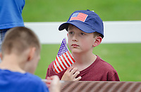 "Michael McCollum<br /> 8/2/18<br /> Alex Overman,7, at the reveal ceremony where it was announced to 13 year old Ryan Overman of west Knoxville that The Wish Connection is granting Ryan's wish to go to Washington DC and visit the White House at Carl Cowan Park, 10058 S Northshore Dr, Knoxville, TN , Thursday, August 2, 2018 at 5:45pm. Approximately 50-60 people attended, including the Overman family, friends, and AT&T Employees. The Bearden High School Cadets also attended and lead the pledge of allegiance.<br />  The AT&T Wish Connection is going to send Ryan, his family, and his service dog to Washington DC and while they are gone, the group of volunteers will be doing a makeover on his bedroom and turn it into the ""Oval Office"" at the White House.<br /> Ryan was born two weeks prematurely on May 13, 2005.  During the pregnancy he was classified as high risk due to a measured lack of growth and, after a brief stay in the hospital, he came home weighing only 4 lbs 5 oz.  His development was much slower compared to his peers, such as not learning to walk until he was well over a year old, and he was much smaller. The Overman family worked with Tennessee Early Intervention Services (TEIS) when Ryan was about one year old and with their help they were able to get Ryan enrolled through TEIS to receive Occupational, Physical, and Speech Therapy.  When Ryan turned three he transitioned from TEIS to the Knox County Early Intervention Program and began attending a special school to continue his therapies until he was old enough to enroll at Cedar Bluff Elementary and now is at Cedar Bluff Middle School. In 2016, Ryan was diagnosed to have retinitis pigmentosa, a degenerative disease of the retinas that under the best of circumstances causes severe tunnel vision, but more commonly results in complete blindness.<br />  Despite the physical difficulties that Ryan has had to endure over the last thirteen years, he continually brightens the lives of those around him.  If someone is hurting or not f"