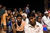 Pilgrims attend the evening prayers at the at the Dashashwamedh Ghat in the ancient city of Varanasi in Uttar Pradesh, India. Photograph: Sanjit Das/Panos