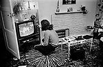 1970s apartment, interior, family at home watching TV, no zapper to tune in TV having to tune in and change channels. London Uk