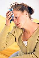 Woman suffering from headaches