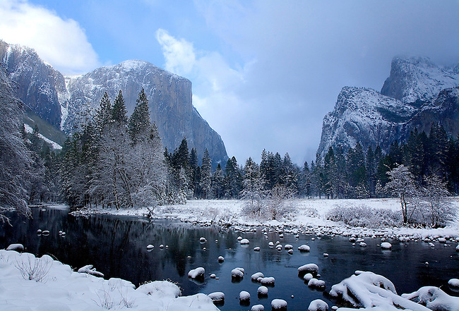 THE MERCED RIVER PROVIDES A FOREGROUND FOR EL CAPITAN AND YOSEMITE VALLEY'S SOUTH RIM AT YOSEMITE NATIONAL PARK, CALIFORNIA