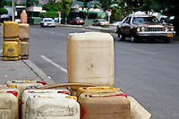 Barrels of the smuggled Venezuelan gasoline are sold along the highways in the border region, close to Cucuta, Colombia, 2 May 2006. Venezuelan gasoline, being 20 times cheaper than in Colombia, is the most wanted smuggling item, followed by food and car parts, while reputable Colombian clothing flow to Venezuela. There are about 25,000 barrels of gasoline crossing illegally the Venezuelan border every day. The risky contraband smuggling, especially during the rainy season when the river rises, makes a living to hundreds of poor families in communities on both sides of the frontier.