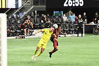 ATLANTA, GA - AUGUST 22: Franco Escobar #2 and Daniel Lovitz #2 contest for a crossed ball during a game between Nashville SC and Atlanta United FC at Mercedes-Benz Stadium on August 22, 2020 in Atlanta, Georgia.
