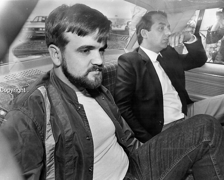 1984 FILE PHOTO - ARCHIVES -<br /> <br /> Shooting suspect: Cpl. Denis Lortie<br />  sits in the back seat of a car arriving at court in Quebec city yesterday. He pleaded not guilty to murder in connection with Tuesday's shootings.<br /> <br /> 1984<br /> <br /> PHOTO : Boris Spremo - Toronto Star Archives - AQP