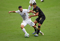 LOS ANGELES, CA - OCTOBER 25: Sebastian Lletget #17 of the Los Angeles Galaxy attempts to move past Mohamed El-Munir #13 of LAFC moves with the ball during a game between Los Angeles Galaxy and Los Angeles FC at Banc of California Stadium on October 25, 2020 in Los Angeles, California.