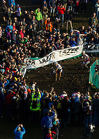 29 NOV 2014 - MILTON KEYNES, GBR - Philipp Walsleben (GER) (centre) from Germany and BKCP-Powerplus  and Klaas Vantornout (BEL) (right) from Belgium and Sunweb-Napoleon Games Cycling Team  negotiate the mud under the watchful eye of the crowd during the men's 2014-2015 UCI Cyclo-Cross World Cup round at Campbell Park in Milton Keynes, Great Britain (PHOTO COPYRIGHT © 2014 NIGEL FARROW, ALL RIGHTS RESERVED)