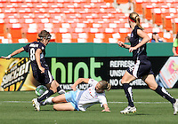 Sonia Bompastor #8 of Washington Freedom is slide tackled by Lindsay Tarpley #5 of Chicago Red Stars during a WPS match at RFK Stadium on June 13 2009, in Washington D.C.