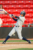 Mason Williams #9 of the Charleston RiverDogs follows through on his swing against the Hickory Crawdads at L.P. Frans Stadium on April 29, 2012 in Hickory, North Carolina.  The Crawdads defeated the RiverDogs 12-3.  (Brian Westerholt/Four Seam Images)