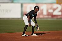 Danville Otterbots shortstop Tyrell Brewer (2) (Charleston Southern)  on defense against the Burlington Sock Puppets at Burlington Athletic Park on June 5, 2021 in Burlington, North Carolina. (Brian Westerholt/Four Seam Images)