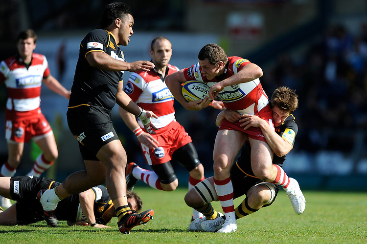 Tim Molenaar of Gloucester Rugby is tackled during the Aviva Premiership match between London Wasps and Gloucester Rugby at Adams Park on Sunday 1st April 2012 (Photo by Rob Munro)