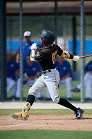 Pittsburgh Pirates center fielder Angel Basabe (87) follows through on a swing during a Florida Instructional League game against the Toronto Blue Jays on September 20, 2018 at the Englebert Complex in Dunedin, Florida.  (Mike Janes/Four Seam Images)