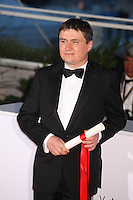 DIRECTOR CRISTIAN MUNGIU, WINNER OF THE BEST DIRECTOR AWARD FOR THE FILM 'BACALAUREAT' - PHOTOCALL OF THE WINNERS AT THE 69TH FESTIVAL OF CANNES 2016