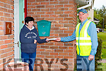 Killarney Postman John O'Shea delivering mail and a friedly chat to Joan Ashe on Friday