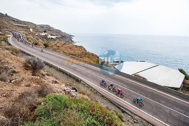 The peloton along the coast during Stage 10 of La Vuelta d'Espana 2021, running 189km from Roquetas de Mar to Rincón de la Victoria, Spain. 24th August 2021.     <br /> Picture: Cxcling | Cyclefile<br /> <br /> All photos usage must carry mandatory copyright credit (© Cyclefile | Cxcling)