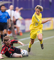 The Crew's Danny Szetela attempts to get by the fallen Eddie Gaven of the MetroStars. The MetroStars defeated the Columbus Crew  2 - 1 at Giant's Stadium, East Rutherford, NJ, on August 14, 2005.