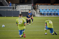 SAN JOSE, CA - OCTOBER 18: Jackson Yueill #14 of the San Jose Earthquakes kneels during a game between Seattle Sounders FC and San Jose Earthquakes at Earthquakes Stadium on October 18, 2020 in San Jose, California.