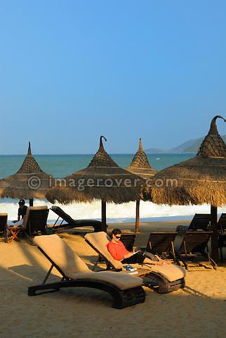 "Asia, Vietnam, Nha Trang. Sun shade at the ""Sailing Club"" beach bar at Nha Trang's beach promenade Tran Phu."