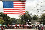 NEWTOWN, CT-1 September 2014-090114EC01--   A giant American flag, 90 x 45 feet, is carried toward the end of the Newtown Labor Day Parade Monday morning. Erin Covey Republican-American