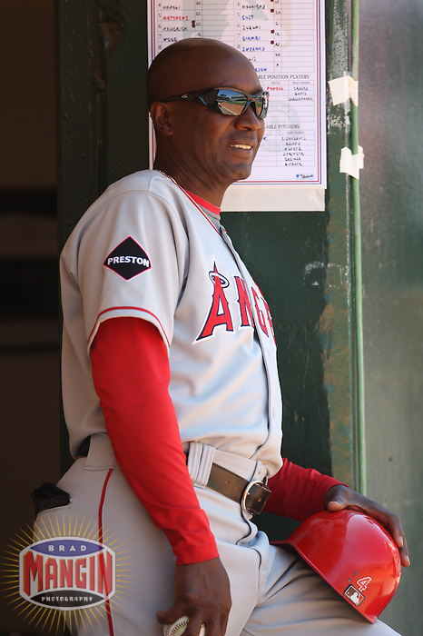 OAKLAND, CA - JULY 19:  Alfredo Griffin #4 of the Los Angeles Angels of Anaheim stands in the dugout against the Oakland Athletics during the game at the Oakland-Alameda County Coliseum on July 19, 2009 in Oakland, California. Photo by Brad Mangin